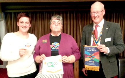 DG Margaret Taylor exchanging banners with John Balshaw and Amy Connors